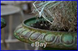 Pair of green cast-iron Medici garden urns
